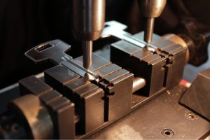 Machine in the Process of Making Two Keys - Harry's Locksmith keys and security services