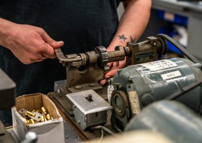 Harry's Locksmith Employee Using a Machine to Make Keys