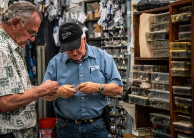 Harry's Locksmith Employee Helping a Customer with His Key
